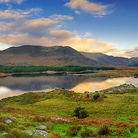 Lough Currane, famous for its sea trout, brown trout and salmon fly fishing nearby Waterville Panorama Sunset with water reflexion, County Kerry, Ireland / wv058
