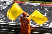 June 19-23, 2019: 24 hours of Nurburgring. Marshal waving yellow flags