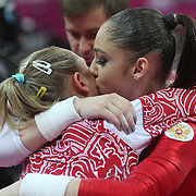 Aliya Mustafina, Russia, (right) hugs team mate Victoria Komova, after winning the Gold Medal in the Gymnastics Artistic, Women's Apparatus, Uneven Bars Final at the London 2012 Olympic games. London, UK. 6th August 2012. Photo Tim Clayton
