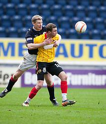 Falkirk's Darren Dods holds onto Christie Elliot..Falkirk 1 v 1 Partick Thistle, 10/3/2012..©Michael Schofield.