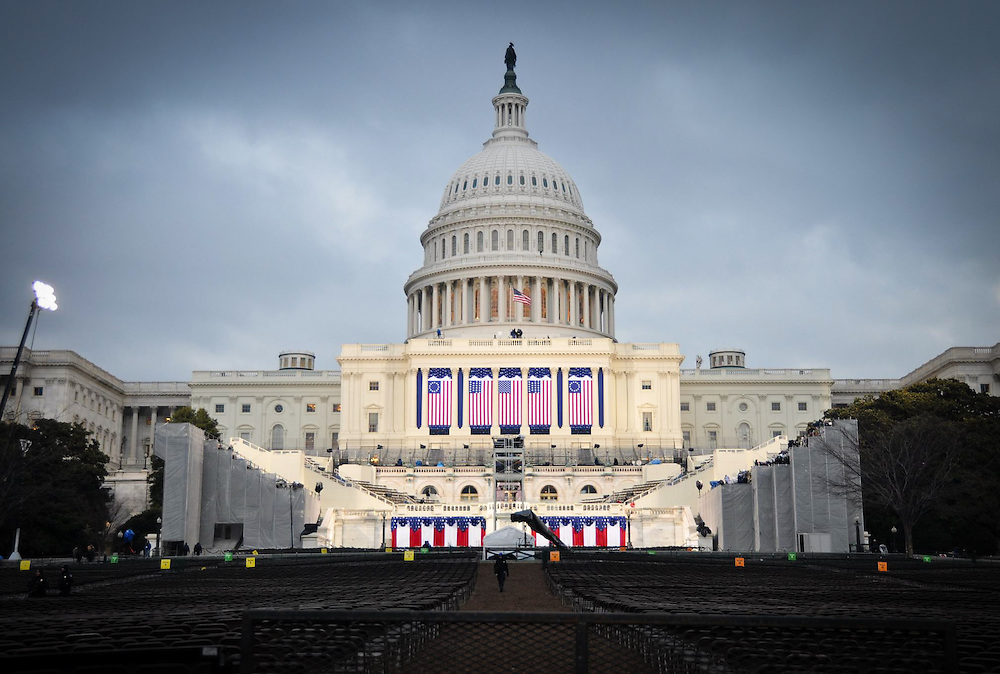 Final preparations are made at the US Capitol building hours before Barack Obama is sworn in as the 44th US president. The VIP podium where the actual swearing in takes place is visible in the center of the image.