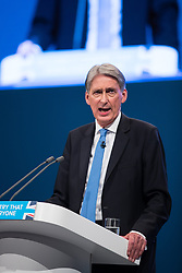 © Licensed to London News Pictures . 02/10/2017. Manchester, UK. Chancellor PHILIP HAMMOND delivers his keynote speech , during the second day of the Conservative Party Conference at the Manchester Central Convention Centre . Photo credit: Joel Goodman/LNP