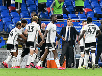 Football - 2019 / 2020 Championship - Play-off semi-final - 1st leg - Cardiff City vs Fulham<br /> <br /> Sulham manager Scott Parker looks on as Neeskens Kebano of Fulham celebrates scoring his team's second goal<br /> in a match played with no crowd due to Covid 19 coronavirus emergency regulations, in an almost empty ground, at the Cardiff City Stadium<br /> <br /> COLORSPORT/WINSTON BYNORTH
