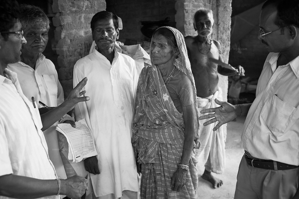 Influencers explaning the importance of polio vaccination to the guardian during the vaccination day on one of the flooded Kosi riverine area near Kusheshwar Astan East, Bihar.