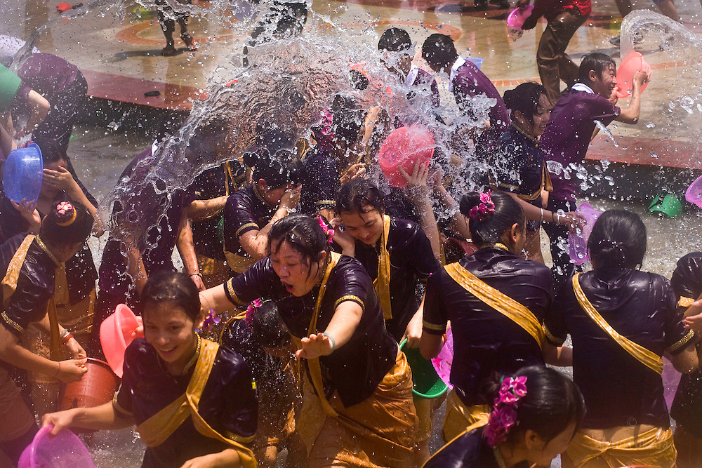 People participate in the annual Water Splashing Festival of the Dai ethnic minority during the New Year celebrations in Yunnan, China.