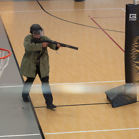 A Navajo Nation police officer, acting the role of the gunman, fires off rounds as he enters the court of the fitness center at the Tséhootsooí Medical Center, as part of the active shooter training exercise, in Window Rock on Thursday.