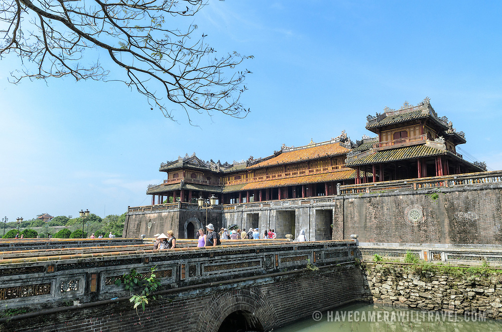 The Citadel gate and bridge at the Imperial City in Hue, Vietnam. A self-enclosed and fortified palace, the complex includes the Purple Forbidden City, which was the inner sanctum of the imperial household, as well as temples, courtyards, gardens, and other buildings. Much of the Imperial City was damaged or destroyed during the Vietnam War. It is now designated as a UNESCO World Heritage site.