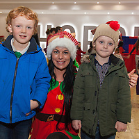 Seanie and Jamie Connellan from Kilmaley with Santas Helper at Shannon Airport