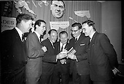 """17/05/1966<br /> 05/17/1966<br /> 17 May 1966<br /> Book reception for """"Decades of Glory: A Comprehensive History of the National Game"""" by Raymond Smith.<br /> This reception was held in the offices of W.D. & H.O. Wills to honour the well known author and journalist, Raymond Smith. His book on the history of Hurling (""""Decades of Glory"""") has just been published with the assistance of Wills of Dublin and Cork and the Central Council of the G.A.A.<br /> Picture shows (from left to right): Ollie Walsh (Kilkenny), Eddie Kehoe (Kilkenny), Jimmy Langton (Kilkenny), Seán Ó Síocháin (General Secretary of the G.A.A.), and Seamus Cleere (Kilkenny)."""