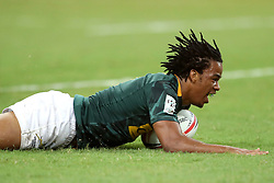 April 29, 2018 - Singapore - Stedman Gans of South Africa scores a try during the Bronze Cup match between South Africa and England at the Rugby Sevens tournament at the National Stadium. Singapore. (Credit Image: © Paul Miller via ZUMA Wire)