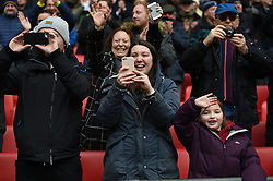 Tottenham Hotspur fans taking pictures on mobile phones