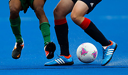 A generic close up shot of Great Britain playing Brazil on the astro turf of the Riverbank Arena hockey pitch at the Riverbank Arena, London.