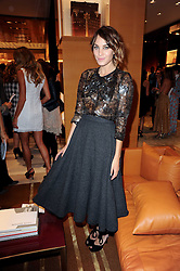 ALEXA CHUNG at a party to celebrate the opening of the Louis Vuitton Bond Street Maison, New Bond Street, London on 25th May 2010.