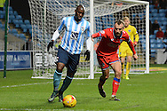 Oldham Athletic midfielder Liam Kelly holds up Coventry City striker Marc-Antoine Fortune during the Sky Bet League 1 match between Coventry City and Oldham Athletic at the Ricoh Arena, Coventry, England on 19 December 2015. Photo by Alan Franklin.