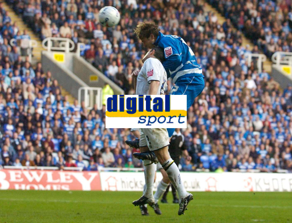 Photo: Alan Crowhurst.<br />Reading v Leeds Utd. Coca Cola Championship.<br />29/10/2005. Reading's Bobby Convey (R) outjumps Gary Kelly for a header on target.