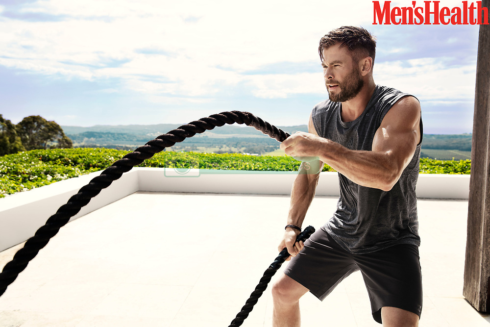 """Chris Hemsworth shared his grueling workout routine in a revealing photoshoot for Men's Health. The Thor actor showed off his bulging biceps on the cover of the fitness mag, which is due to hit US newsstands on February 12. The March edition is also set to go on sale in the UK and Australia. During the photo shoot, which was taken in Byron Bay, Australia, the movie star shared a number of fitness tips. He also recorded a short video detailing his routine, which includes push-ups, battle ropes, medicine ball slams and Russian twists. During an interview with the magazine, he also went on to say that he nearly gave up on acting after missing out on the role of Captain Kirk in 2009's Star Trek. He said"""" """"I was about to quit. I always wanted to act, and one of the first things I wanted to do when I got any money was pay my parents' house off. I'd asked Dad once when he thought he'd pay it off and he said, """"Honestly, probably never."""" I wanted to change that. So I was super active with auditions. And then my mentality changed, which came from being at a point where I was like, """"I'm going to go back to Australia."""" I had one more audition where I was like, """"Do this for his house. Think about reasons other than yourself."""" That was for The Cabin in the Woods, and I got that job, and from there I got Red Dawn. And then I got Thor."""" He also claimed that he always likes to maintain his physique in case he is ever caught off guard by the paparazzi, adding: """"It comes hand in hand with the roles I play, but look, occasionally you'll see paparazzi poking out of the bushes and you're like, """"How's my rig look? Am I on point, or have I slacked off lately?"""" I maintain my fitness because it makes me feel better."""" Hemsworth also spoke about his new fitness app Centr, which he hopes will help revolutionize fitness. He said """" """"The whole thing was about not becoming stagnant. That's when your emotional and physical problems occur, I think. I wanted to"""