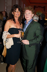 Musician MICK HUCKNALL and GABRIELLA WILKE-WESBERRY at a party to celebrattte the 150th anniversary of Kensington Palace Gardens in aid of the British Red Cross held at The Orangery, Kensington Palace, London on 7th July 2004.