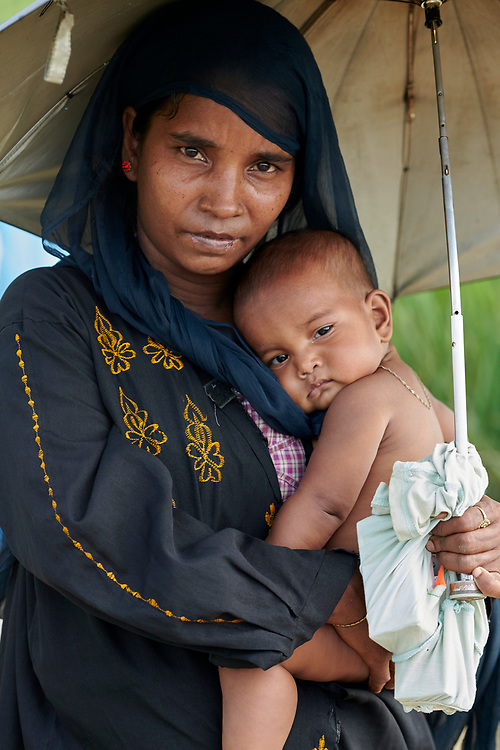 A Rohingya woman and her child in the Jamtoli Refugee Camp near Cox's Bazar, Bangladesh. More than 600,000 Rohingya have fled government-sanctioned violence in Myanmar for safety in Bangladesh.