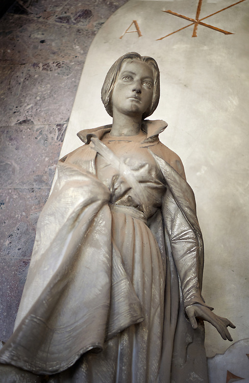 Picture of the stone sculpture of a women in Art Nouveau style. The G.B. Susto Family Tomb sculpted by L Beltrami in 1904. The monumental tombs of the Staglieno Monumental Cemetery, Genoa, Italy .<br /> <br /> Visit our ITALY PHOTO COLLECTION for more   photos of Italy to download or buy as prints https://funkystock.photoshelter.com/gallery-collection/2b-Pictures-Images-of-Italy-Photos-of-Italian-Historic-Landmark-Sites/C0000qxA2zGFjd_k<br /> If you prefer to buy from our ALAMY PHOTO LIBRARY  Collection visit : https://www.alamy.com/portfolio/paul-williams-funkystock/camposanto-di-staglieno-cemetery-genoa.html