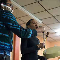"""012815      Cayla Nimmo<br /> <br /> Radmilla Cody performs a song for the for the forum, """"Gallup: A Border Town of Violence,"""" in the Hozho Center in Gallup Wednesday night."""