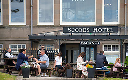 People eating in at outdoor tables at Scores Hotel in St Andrews, Fife, Scotland, UK