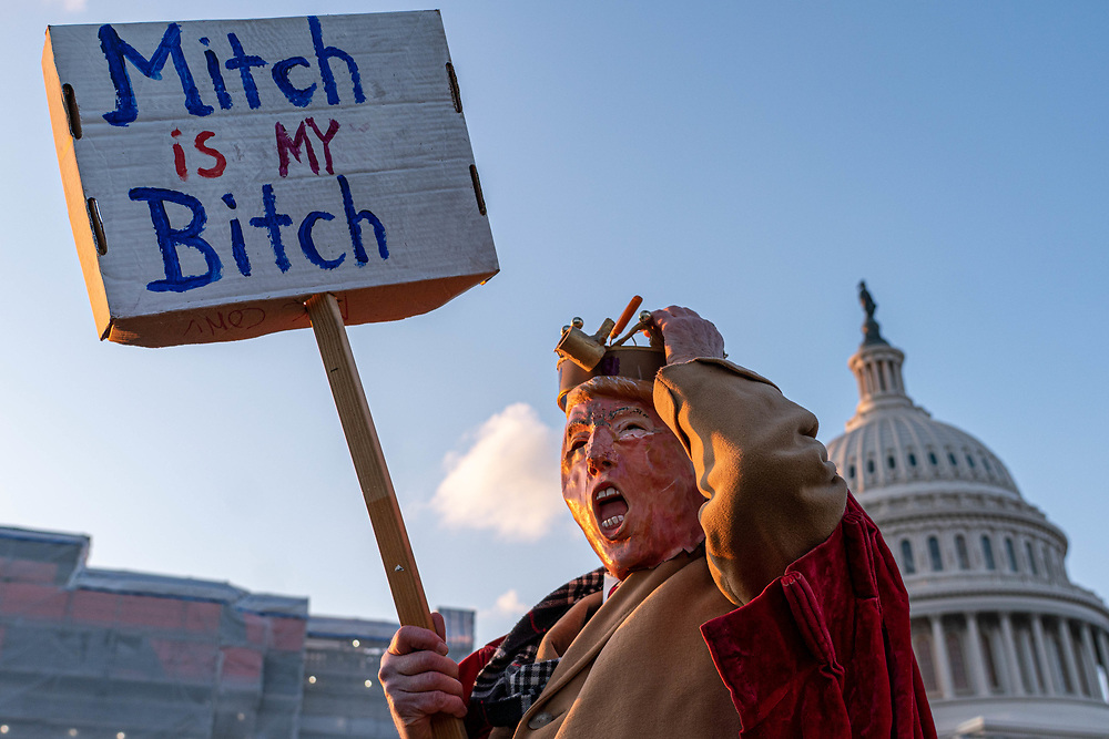 David Barrows dresses as President Trump in front of capital Dec. 18, 2019, in Washington DC. The House votes on impeachment of President Trump who will be the fourth American President facing impeachment. The president is accused of obstruction of Congress and abuse of power.    Photo Credit: Ken Cedeno/Sipa USA