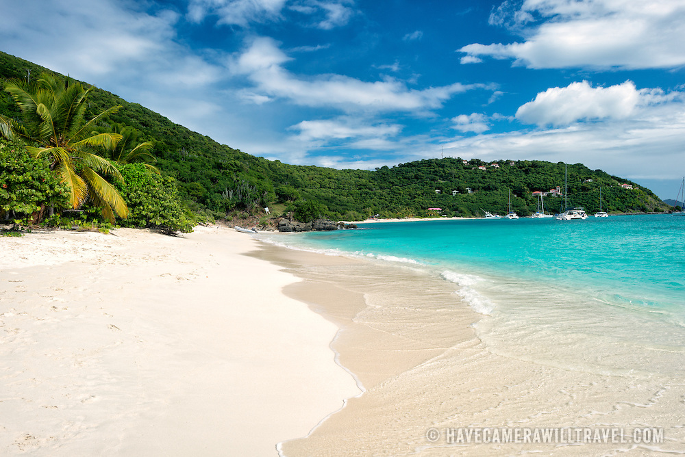 The idyllic tropical sandy beach at White Bay on Jost Van Dyke in the British Virgin Islands. The beach, on the southern coast of Jost Van Dyke, is famous for a string of bars serving tropical drinks, most famously the Soggy Dollar Bar, and is a popular stop for day boaters.