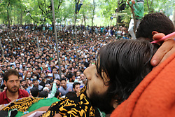 June 17, 2017 - Shopian, Jammu and Kashmir, India - (EDITORS NOTE: Image depicts death.) Thousands attended the funeral of a slain Kashmiri rebel Nasir Ah Wani looks towards dead body during a Funeral at at Heff Shopian. Wani was killed along with Commander Junaid Mattoo and Adil Mushtaq in a gunfight with forces in Arwani Anantnag. Two civilians also killed when they protested near the encounter site. (Credit Image: © Muneeb Ul Islam/Pacific Press via ZUMA Wire)