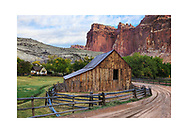The Gifford Homestead barn and house at Capitol Reef National Park in autumn, Utah, USA - There are two versions of this image, the dirt road is placed digitally.