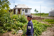Boy walking in the Roma area of Frumusani. In Frumusani, the Roma Education Fund—supported by the World Bank, Open Society Foundations, the European Union, and other donors—is working to remove the barriers local Roma children face to complete their primary school education.