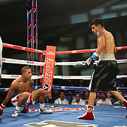 ORLANDO, FL - OCTOBER 04:  Jantony Ortiz (L) hits the mat after being punched by Gilberto Mendoza during a professional super flyweight boxing match at the Bahía Shriners Auditorium & Events Center on October 4, 2014 in Orlando, Florida. Ortiz would go on to win the fight. (Photo by Alex Menendez/Getty Images) *** Local Caption *** Jantony Ortiz; Gilberto Mendoza