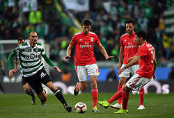 LISBON, Feb. 4, 2019  Andre Almeida (1st R) of Benfica vies with Bas Dost (1st L) of Sporting during the Portuguese League soccer match between SL Benfica and Sporting CP in Lisbon, Portugal, Feb. 3, 2019. Benfica won 4-2. (Credit Image: © Xinhua via ZUMA Wire)