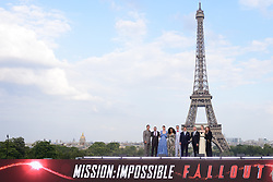 Henry Cavill, Jake Myers, Michelle Monaghan, Angela Bassett, Christopher McQuarrie, Tom Cruise, Simon Pegg, Vanessa Kirby and Rebecca Ferguson pose in front of the Eiffel Tower during the Global Premiere of Mission: Impossible - Fallout at Palais de Chaillot in Paris, France on July 12, 2018. Photo by Aurore Marechal/ABACAPRESS.COM