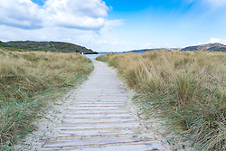 Footpath in sand dunes leading to beach at Clachtoll in Assynt on the North Coast 500 scenic driving route in northern Scotland, UK