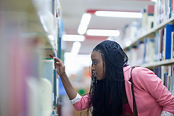 Female student choosing book in library (Credit Image: © Image Source/Albert Van Rosendaa/Image Source/ZUMAPRESS.com)