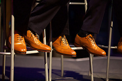 CARDIFF, WALES - Wednesday, June 1, 2016: The brown shoes of Wales' captain Ashley Williams and Gareth Bale during a Q&A at a charity send-off gala dinner at the Vale Resort Hotel ahead of the UEFA Euro 2016. (Pic by David Rawcliffe/Propaganda)