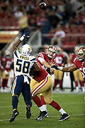 Los Angeles Chargers rookie linebacker Uchenna Nwosu (58) leaps as he tries to block a pass during the 2018 NFL preseason week 4 football game against the San Francisco 49ers on Thursday, Aug. 30, 2018 in Santa Clara, Calif. The Chargers won the game 23-21. (©Paul Anthony Spinelli)