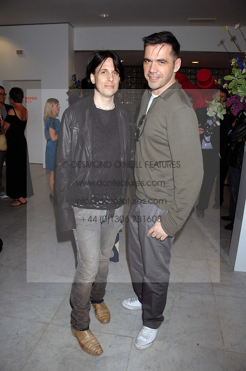 Left to right, designers TODD LYNN and ROLAND MOURET at a reception hosted by Vogue magazine to launch photographer Tim Walker's book 'Pictures' sponsored by Nude, held at The Design Museum, Shad Thames, London SE1 on 8th May 2008.<br /><br />NON EXCLUSIVE - WORLD RIGHTS