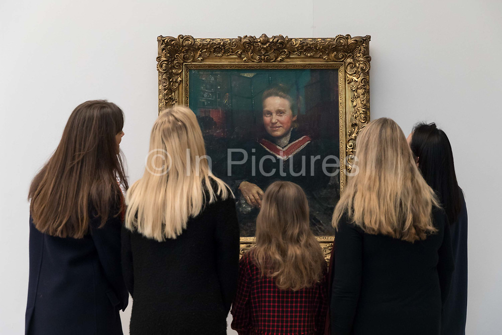 Women view Annie Swynnerton's oil portrait of the suffragist, Millicent Fawcett, which is displayed at Tate Britain art gallery on 2nd February 2018 in London, England, United Kingdom, to mark the centenary anniversary of of the Representation of the People Act, which gave women over 30 the right to vote. The suffragist, Fawcett was a political and union leader and writer known for her work as a campaigner for women to have the vote. Swynnerton was a pioneering artist, one of the first women to be elected a member of the Royal Academy of Arts and a strong advocate of women's rights.