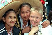 Kids age 12 wearing sombreros at Cinco de Mayo festival.  St Paul Minnesota USA