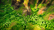 Lush valley and cliffs (aerial), Nualolo Kai State Park, Kauai, Hawaii USA