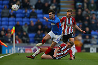 Football - 2019 / 2020 Emirates FA Cup - Second Round: Portsmouth vs. Altrincham<br /> <br /> Jake Moult of Altrincham slides in to win the ball from Portsmouth's John Marquis during the FA Cup match at Fratton Park <br /> <br /> COLORSPORT/SHAUN BOGGUST