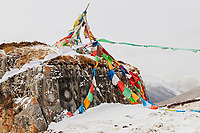 Snow covered mountain landscape and prayer flags, China, Sichuan Province, Garze Prefecture, Serxu County.