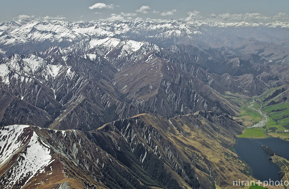 This picture was made enroute to Milford Sound, New Zealand on a chartered single-prop plane. The Richardson Mountain ranges in the picture are just outside of Queenstown on the northwestern region of the Fiordland National Park. Moke Lake is also visible in the picture.