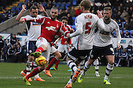 Nottingham Forest's Henri Lansbury (c) battles for the ball in the penalty box. Skybet championship match, Bolton Wanderers v Nottingham Forest at the Reebok Stadium in Bolton, England on Saturday 11th Jan 2014.<br /> pic by David Richards, Andrew Orchard sports photography.