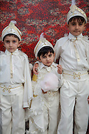 Yusuf Ünal, left, Yahya Kemal Ünal, centre, and Kekta Selami Ünal, right, three brothers after their traditional circumcision in Sariyer, a town on the Bosphorus coastline north of Istanbul. The boys dress in costumes of Ottoman sultans on the day when they are seen as stepping into manhood.