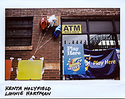 Balloons blow in the wind as part of a memorial for Kenta Holyfield, 39-year-old, and Lonnie Hartman, 31-year-old, outside a store in the 3800 block of West Augusta in Chicago in this photo taken October 28, 2017. Holyfield who died from gunshots to his head and chest, and Hartman who was shot multiple times in his body, were both murdered on October 27, 2017.