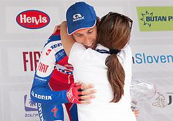 Winner Radoslav Rogina (CRO) of Adria Mobil celebrates with Mojca Novak at flower ceremony during Stage 3 from Skofja Loka to Vrsic (170 km) of cycling race 20th Tour de Slovenie 2013,  on June 15, 2013 in Slovenia. (Photo By Vid Ponikvar / Sportida)