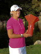 29 MAR15  Christie Kerr holds the winners trophy at the conclusion of Sunday's Final Round of The KIA Classic at Aviara Golf Club in LaCosta, California. (photo credit : kenneth e. dennis/kendennisphoto.com)