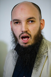 © Licensed to London News Pictures. 26/02/2015. LONDON, UK. Cerie Bullivant from CAGE human rights organisation talk to media about British man Mohammed Emwazi, who believed to be Islamic State militant known as 'Jihadi John' during a press conference in central London on Thursday, 26 February 2015. Photo credit : Tolga Akmen/LNP